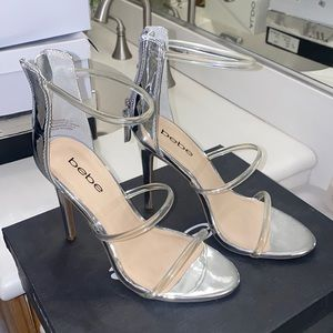 Bebe silver and clear heels